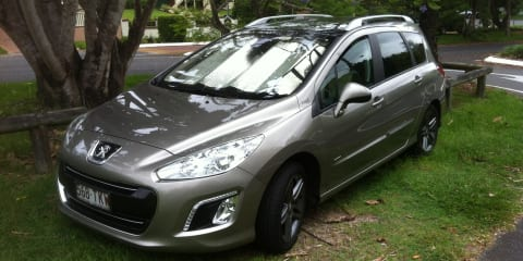2013 Peugeot 308 Sportium Touring HDi Review