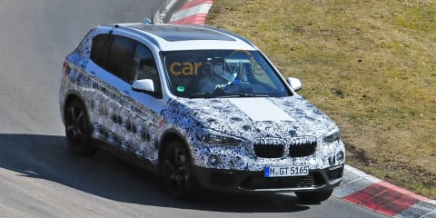 2015 BMW X1 spied with less camouflage on Nurburgring, and in Scandinavia