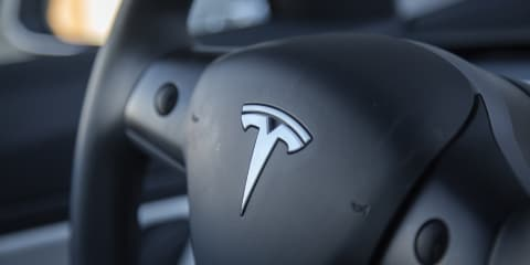 Tesla slashes workforce, ends referral program