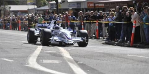 Kinglake fire victims treated to F1 display