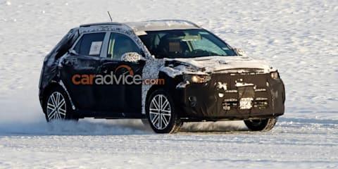 Kia's overdue small SUV spied
