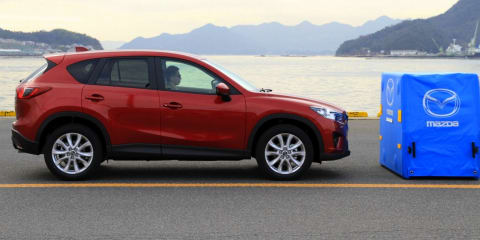 Mazda CX-5 city brake safety demonstration ends in injury