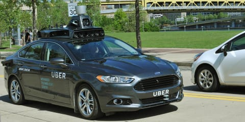 Uber reveals driverless Ford Mondeo prototype