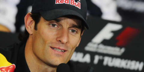 Mark Webber signs with Red Bull Racing for 2011