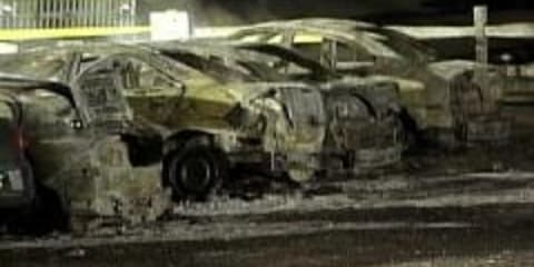 US car dealer dies torching own vehicles