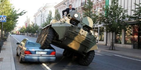 Lithuanian mayor crushes luxury car parked in bike lane with a tank