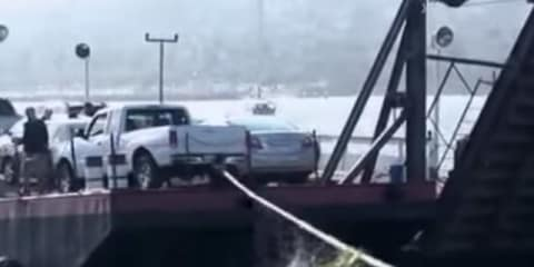 Mazda B3000 pick-up truck goes into ocean after someone ties a rope to the back