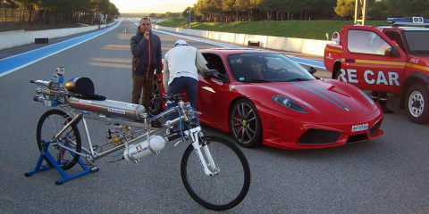 Rocket-powered bicycle hits 333km/h, leaves Ferrari 430 Scuderia in its wake