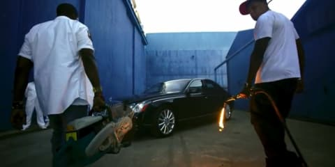 Jay-Z and Kanye West destroy Maybach in Otis film clip