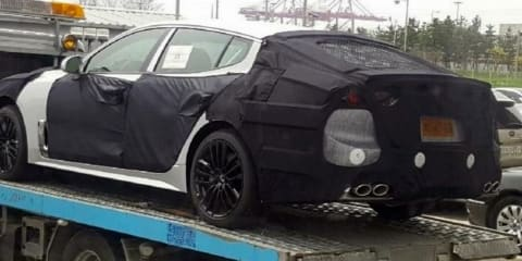 Kia's new sports sedan spied in heavy camouflage