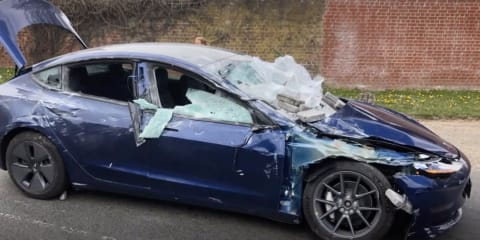 Video: Tesla Model 3 crushed by concrete blocks; driver and passenger virtually unharmed