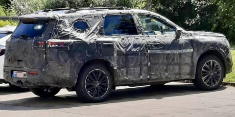 2021 Nissan Pathfinder spied in cloth-tape camo