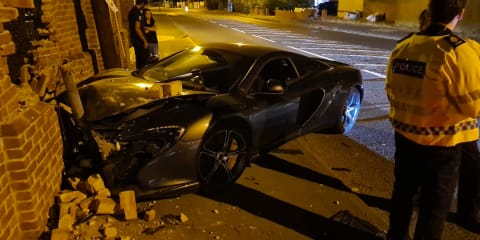 Driver ploughs McLaren supercar into a brick wall in the UK