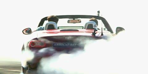 Mazda MX-5 drops top for Frisbee fun