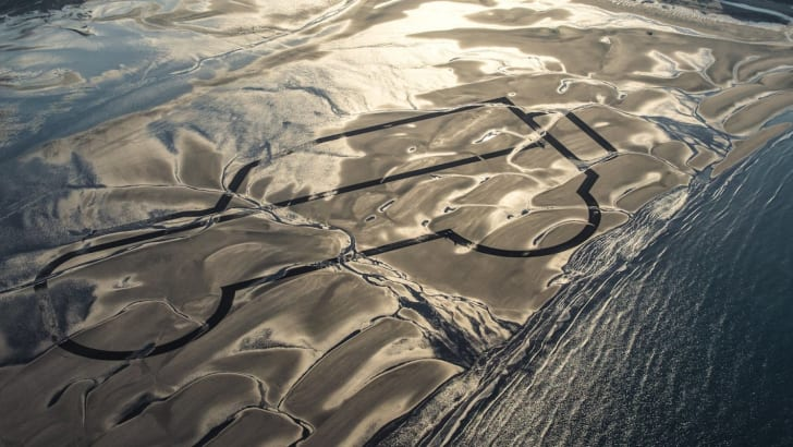 Land Rover Launches A Year Of Defender Celebrations With Giant 1km Sand Drawing And Two Limited Editions