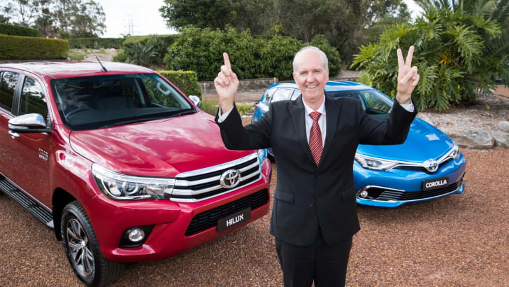 Toyota Australia's Tony Cramb with a HiLux SR5 and Corolla Hybrid