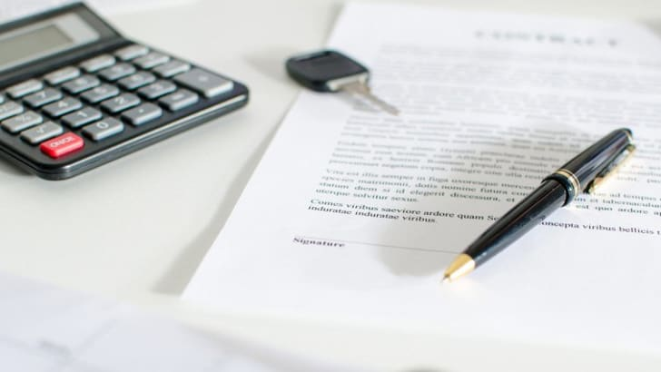 Sales contract, key, pen and calculator