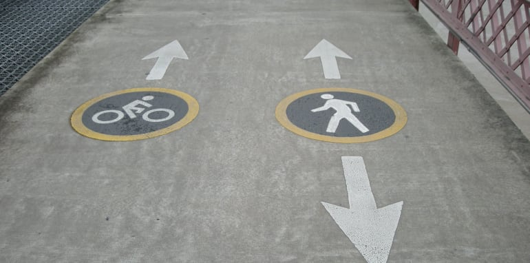 Pedestrian and bicycle markings on footpath