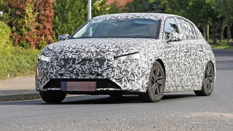 2022 Peugeot 308 spy photos reveal retro logo on steering wheel