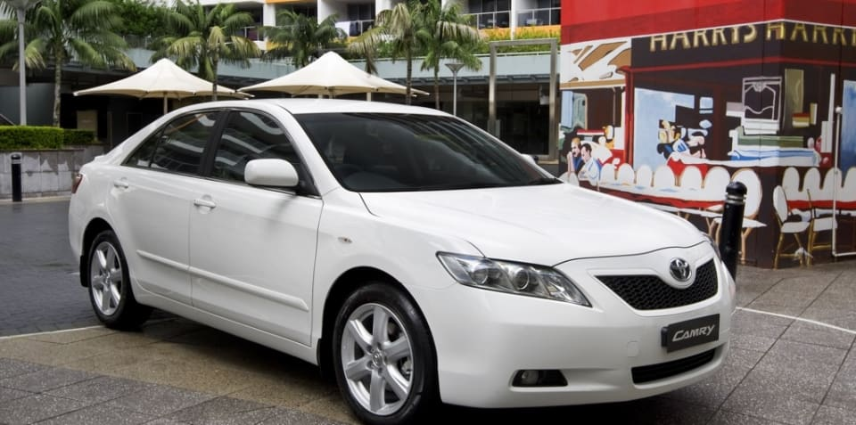 Toyota halves profit on sales downturn