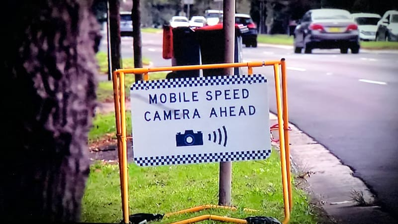 Speed camera warning signs return in NSW after record fines, public backlash, rising road toll